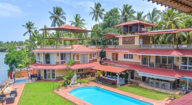The river palace goa room rates reviews deals - Guest house in goa with swimming pool ...