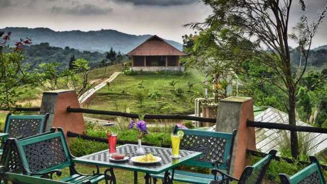 Heritage resort coorg room rates reviews deals Hotels in coorg with swimming pool