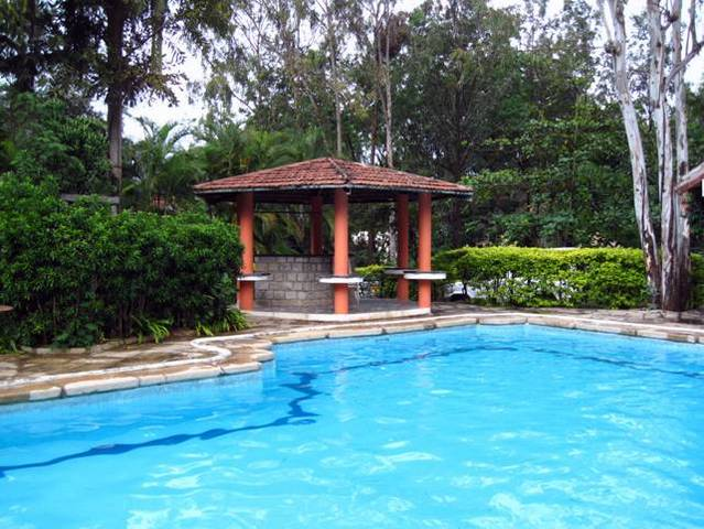 Eagle ridge resort bangalore room rates reviews deals for Bangalore resorts with swimming pool