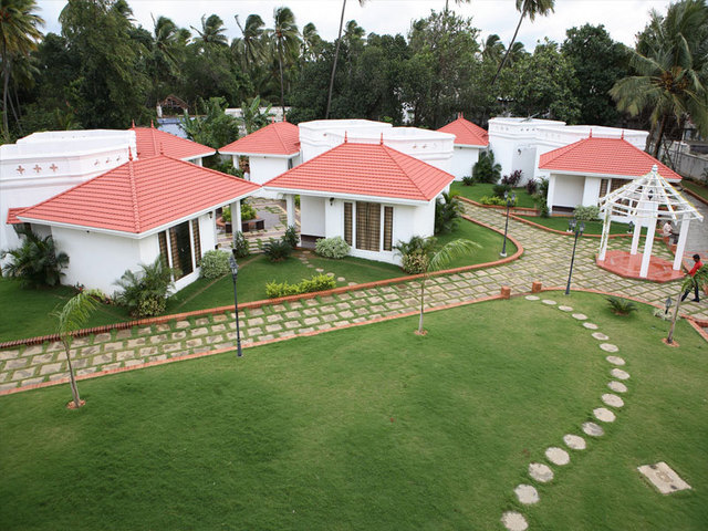 The kuttalam heritage courtrallam use coupon code bestbuy for Kodaikanal cottage with swimming pool
