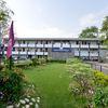 A_well-manicured_green_belt_adorns_Sunbird_Resort_(3)